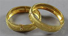 PAIR STAMPED 99 YELLOW GOLD TONE HINGED BANGLE BRACELETS, 2 1/8