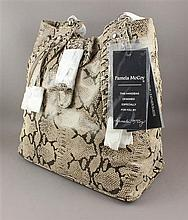 PAMELA MCCOY EMBOSSED LEATHER REPTILE PATTERN PURSE WITH RIVETED HANDLES AND ORIGINAL TAGS