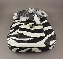DOONEY & BOURKE BROWN AND WHITE ZEBRA TEAR DROP HOBO BAG WITH ORIGINAL TAGS