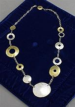 SIGNED ROBERT LEE MORRIS STERLING SILVER AND BRASS DISC LINK NECKLACE