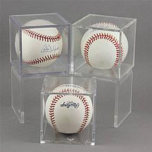 (3) SIGNED BASEBALLS IN CASES, CARLOS DELGADO, LOU BOUDREAU AND JOSE CONSECO