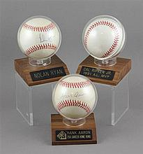 (3) SIGNED BASEBALLS IN CASES, NOLAN RYAN, HANK AARON, CAL RIPKIA, JR