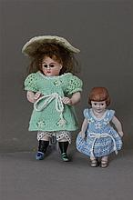2 GERMAN ALL BISQUE DOLLS INCLUDING 4