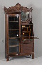 TURN OF CENTURY OAK SIDE BY SIDE SECRETARY BOOKCASE WITH BOWED GLASS DOOR AND BEVELED GLASS MIRROR