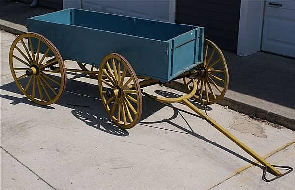 CHILDS WOODEN PONY OR PULL WAGON WITH WOOD WHEELS