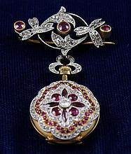 HALLMARKED YELLOW GOLD DIAMOND AND SYNTHETIC RUBY PENDANT WATCH WITH PIN, 2 1/4