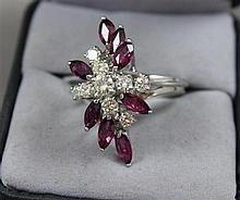 STAMPED 14K WHITE GOLD APPROX .79 CT TW DIAMOND AND APPROX 1.60 CT TW RUBY FASHION RING, SIZE 6 1/4, 6.6 GRAMS, REPLACEMENT VALUE $4...