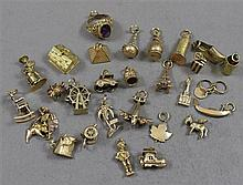 28 TRAVEL CHARMS INCLUDING STAMPED 10K, 14K AND 18K, 1/2