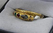 UNMARKED YELLOW GOLD SNAKE RING WITH GEMSTONE ACCENTS, SIZE 8 3/4, TESTS 22K, 5.8 GRAMS TOTAL