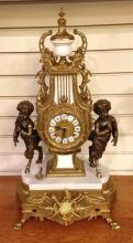 DECORATIVE BRASS MANTEL CLOCK WITH FAUN FIGURES ON MARBLE BASE, 24.5