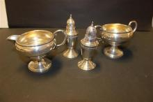 4 PIECES WEIGHTED STERLING SILVER FOOTED SALT AND PEPPER AND CREAM AND SUGER 3 3/4