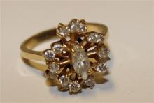 STAMPED 14K YELLOW GOLD APPROX .26 CT MARQUISE DIAMOND FASHION RING WITH 16 SURROUNDING DIAMONDS, SIZE 5 1/4, 3.5 GRAMS TOTAL, REPLA...
