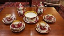 21 PIECES CHINA DESSERT SET WITH FLORAL AND GOLD DECORATION, TEAPOT IS 10