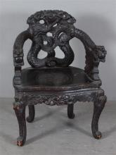 HIGHLY CARVED ASIAN CHAIR WITH FIGURAL ARMS, 24