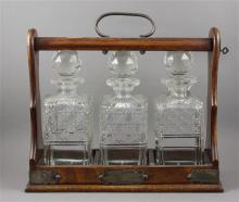 TANTALUS IN OAK FRAME WITH 3 CUT GLASS DECANTERS - 13