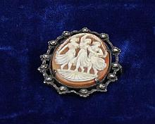 MARKED 835 SILVER FRAMED CAMEO PIN WITH MARCASITE ACCENTS, 1 1/2
