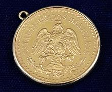 1945 MEXICAN 50 PESOS 1 1/4 OZ. GOLD COIN IN GOLD BEZEL, 44.36 GRAMS TW
