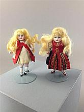2 SMALL GERMAN ALL BISQUE DOLLS IN REGIONAL DRESS. ONE HAS DAMAGE TO TOP OF LEG AS SHOWN. BOTH MEASURE 3 1/2