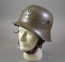 AUSTRIAN M16 HELMET WITH POLISH ARMY BADE
