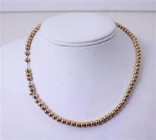 STAMPED 14K YELLOW GOLD BEADED NECKLACE, 16