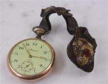 TACY ADMIRAL GOLDTONE OPEN FACE 7 JEWELS POCKET WATCH, 45 MM DIAMETER WITH LEATHER AND CELLULOID LION FOB