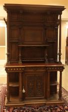 HIGHLY CARVED FRENCH WALNUT VICTORIAN SIDEBOARD WITH RED MARBLE TOP, RAISED PANELS, AND BACKBOARD WITH REEDED COLUMNS, 58