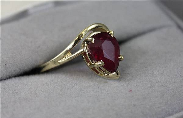 14K YELLOW GOLD 3.12CT PEAR SHAPED ENHANCED RUBY RING