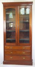 Victorian Mahogany Bookcase. 19thc. The glazed two door top concealing 4 adjustable shelves over 3 large drawers all on a plinth base. Height 102 in. Width 50 in.Depth 14 in.