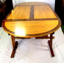 Boardroom Table in Mahogany with Burr Walnut Crossbanding. 8 sections to Include 2 x Demi Lune Ends & 6 x Tables. All with fold up oak legs with locking catches.. Total length assembled 19 feet 9 inches. Height 29 inches.