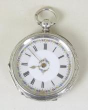 Silver Engraved Ladies Pocket Watch with Gold and Enameled White Dial. Circa 1883. Maker LC. Hallmarked Birmingham.