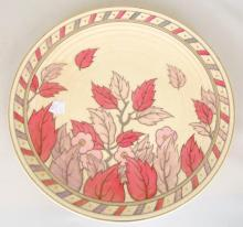 Charlotte Rhead 'Falling Leaves' Charger, Pattern 4921. Printed and painted factory marks. Diameter 14 inches.