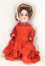 A Gebruder Kuhnlenz German Bisque Headed Doll. 19thc. With composition limbs, stamped Gbr 165 K 8 Germany. Height 16.5 inches.