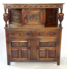 Jaycee Carved Oak Court Cupboard 20thc. Height 52 in. Width 48 in. Depth 18.5 inches.