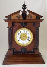 A Fattorini and Sons, Bradford  Oak Cased Mantle Clock. Early 1900s with patent automatic alarm. Working order with key. Height 18in.