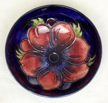 Moorcroft Footed Bowl with Anemone Decoration on Blue Ground. Diameter 4 3/4 inches.