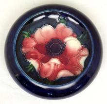 Moorcroft Lipped Bowl with Anemone Decoration on Blue Ground. Diameter 4 3/4 inches.
