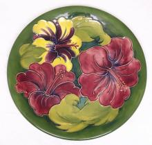 Moorcroft Charger with Hibiscus Decoration on Green Ground. Monogrammed W.M to Base. Diameter 10 1/2 inches
