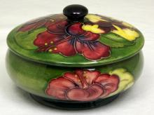 Moorcroft Lidded Powder Bowl with Hibiscus Decoration on Green Ground. Paper Label 'HM The Late Queen Mary' Height 3 inches, Diameter 5 inches