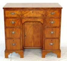 Antique Style Walnut Kneehole Desk. Height 30 inches, Width 33 inches, Depth 18 1/2 inches.