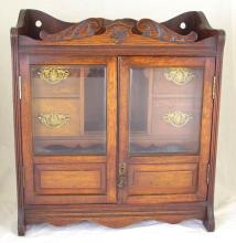 Good Antique Victorian Carved Oak Smokers Cabinet. C.1894. Having two beveled glass doors on opening revealing 4 drawers and brass pipe racks.. Stamped Reg. No. 236189. Height 18 in. Width 16 in. Depth 8 in.