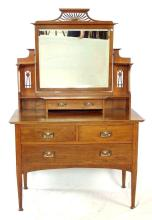 Antique Art Nouveau Oak Dressing Table. Circa 1900s. The stylised mirror supports over a jewel drawer and 3 storage drawers with nouveau handles all supported on tapering turned legs. Height 65 in. Width 42 in. Depth 21 in.
