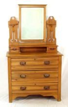 Antique Edwardian Satinwood Dressing Table. Circa 1902. The central bevelled mirror flanked by jewel drawers over 3 storage drawers all supported on bracket feet. Height 62 in. Width 36 in. Depth 17.5 in.