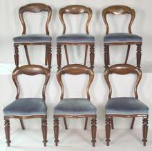 Victorian Mahogany Set of Six Balloon Back Dining Chairs. 19thc. The carved backs over serpentine padded seats on fluted tapered legs. Height 33 in. (6 Items)