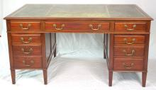 Large Vintage Mahogany Pedestal Desk. Early 20thc. The inset leather writing surface over 3 drawers supported on two pedestals each with 3 drawers all having brass swan neck handles.Height 30 1/2in. Width 60in. Depth 36 in.