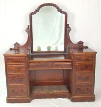 Nice Antique Victorian Mahogany Dressing Table. 19thc. The shaped mirror over a single centre drawer and footrest, flanked by 4 drawer pedestals. Height 67 in. Width 60in. Depth 19 in.