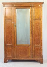 Edwardian Oak Double Wardrobe. Early 20thc. Height 74 in. Width 51 in. Depth 21 in.