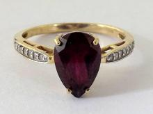 A Natural Pear Faceted 2.50 carat Ruby and Diamonds Engagemant Ring. Claw set in a beautiful 9ct Yellow Gold setting. Hallmarked .375. Size O (US 15) Boxed