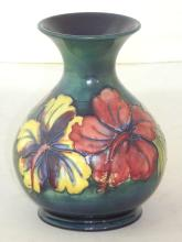 Moorcroft Signed Bulbous Vase with Hibiscus Decoration on Green Ground. Factory marks to base. Height 15.5cm