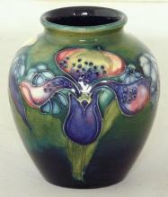 Moorcroft Bulbous Vase with Orchid Decoration on Green Ground. Factory marks to base. Height 10.5cm