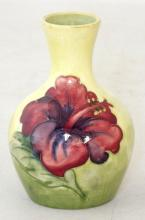 Moorcroft Vase with Hibiscus Decoration on Yellow Ground. Factory marks to base. Height 9.5cm